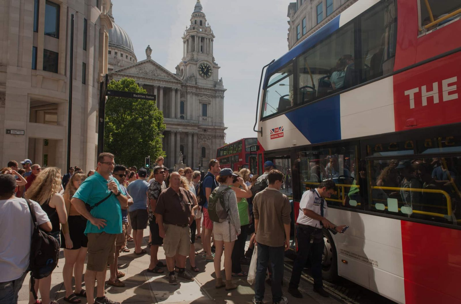 People queuing for bus